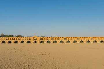 Khaju bridge over the dried up Zayandehrud river in Isfahan, Iran.