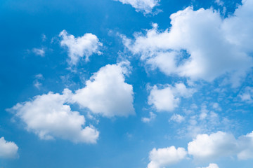 The blue sky with moving white clouds. The sky is a beautiful color shade suitable for use as a background image.