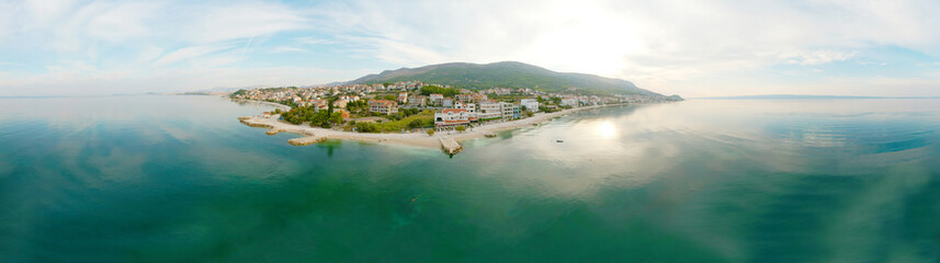 Poster Cote Scenic aerial bird view at morning coastal village near Split in Croatia, calm and quite tourist vocational hotel seafront under green mountains in Europe. 360 panoramic photography.