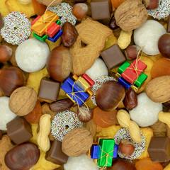 quadratischer Weihnachtshintergrund aus verschiedenen Sorten von Weihnachtsplätzchen,  Süssigkeiten und Nüssen