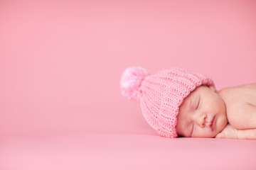 Newborn Baby Girl in Knit Hat, Isolated on Pink, Room for Text