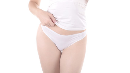 Female cropped hips in white panties and tank top, isolated on white.
