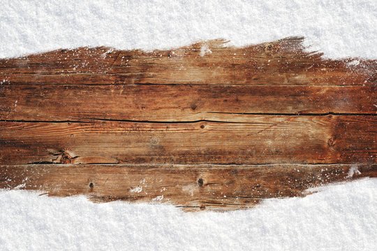 Christmas rustic wood background with snow