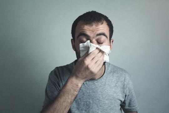 Man blowing his nose. Healthy medicine concept