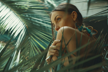 Portrait exotic woman among tropical plants, fashion, beauty, co Wall mural