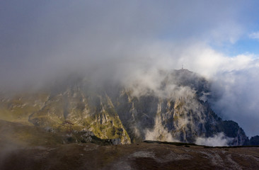 Carpathian Mountains peaks on a foggy autumn morning. Bucegi Mountains, Romania
