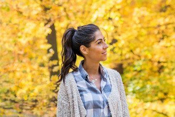 Beautiful Young Happy Woman in  Autumn Park with Yellow Trees.Autumn Season Time