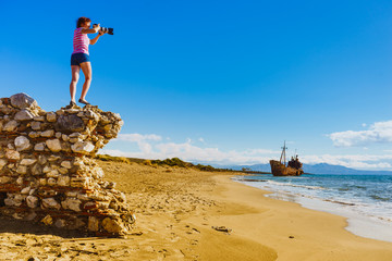 Tourist take photo on beach sea shore