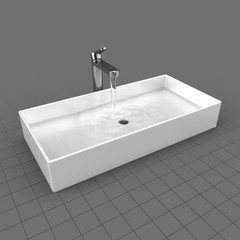 Water flowing in modern bathroom sink