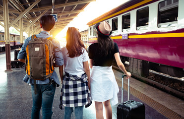 Groug of tourist greeting and happiness after traveller by train