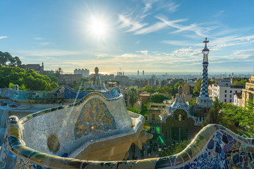 City view with a clear blue sky from the top of Park Guell in Barcelona. Park Guell is one of the famous architect Antoni Gaudi's major works. It is among the most popular tourist attractions.