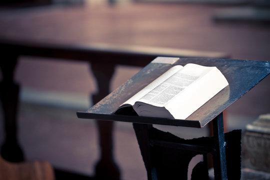 Open book above a lectern in church