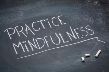practice mindfulness text on blackboard