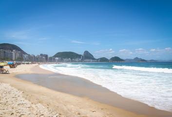 Copacabana Beach with Sugar Loaf Mountain on Background - Rio de Janeiro, Brazil