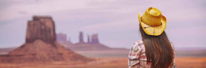 Cowgirl woman enjoying view of Monument Valley in cowboy hat. Beautiful young girl in outdoors, Arizona Utah, USA. Banner panorama.
