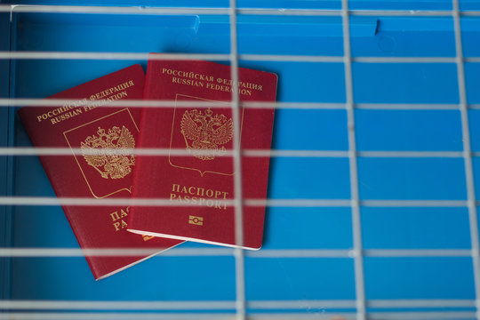 Sanctions against Russia: Passport behind bars closed in cage