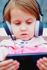 Social Media addiction. Little child girl holding smart phone (psychological problems, media mania concept)