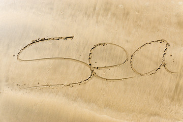 The inscription on the sand of the sea