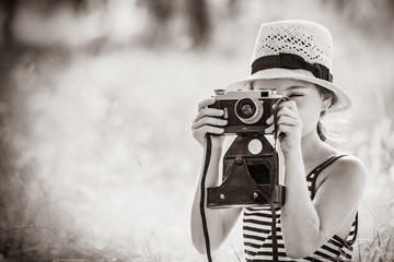 photo of the beautiful girl taking photos with her camera . Image in black and white color style