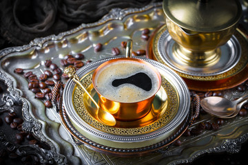 Black coffee in a cup on old background