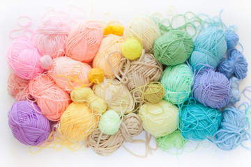 Colored balls of yarn. View from above. Rainbow colors. All colors. Yarn for knitting. Skeins of yarn.