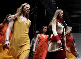 Models present creations from the Bobstore collection during the Sao Paulo Fashion Week