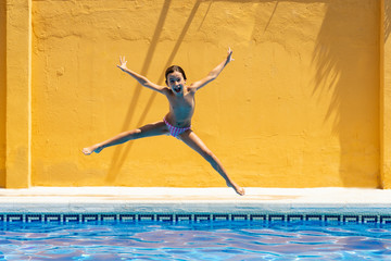 Portrait of girl jumping in swimming pool
