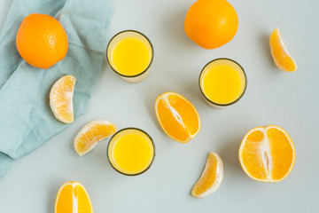 Glasses of freshly squeezed orange juice and orange slices