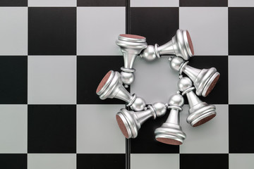 Chess board game idea of management strategy without leadership concept