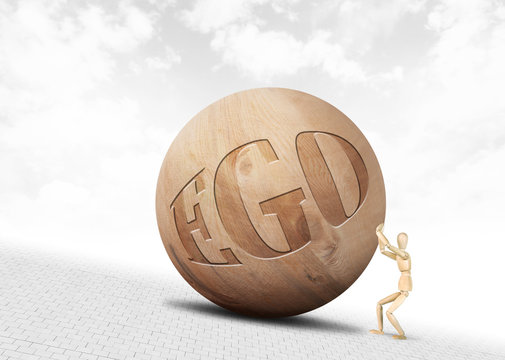 Man pushes a huge wooden ball with inscription Ego upwards along the slope. Abstract image with a wooden puppet