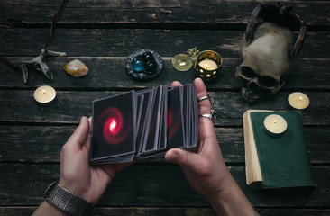 Tarot cards on fortune teller desk table background. Futune reading concept. Divination.