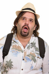 Fat bearded Caucasian tourist man looking tired