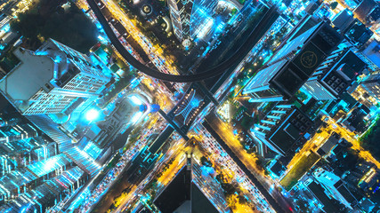Aerial view traffic road at night in downtown for transportation or traffic background. Wall mural