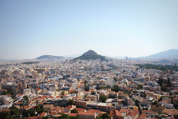 View over the city and the Lycabettus hill from Acropolis in Athens, Greece. Panorama of Athens . Beautiful cityscape with seashore