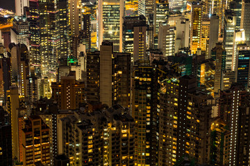 Hong Kong City at night. Close up view of skyscrapers and city lights, skyline
