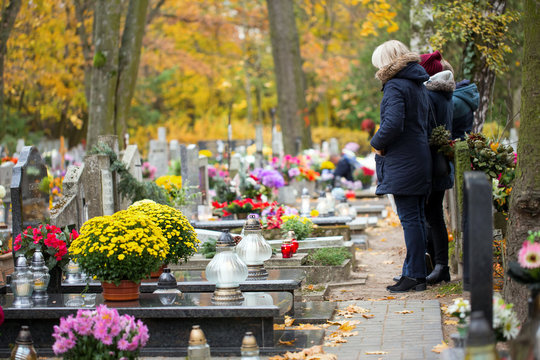 Family at the cemetery are praying at the grave