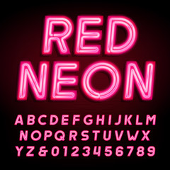 Red neon tube alphabet font. Neon color letters and numbers on a dark background. Vector typeface for your design.