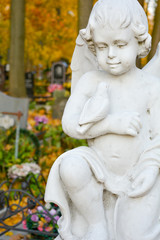 White Stone Sculpture of Guardian Little Angel