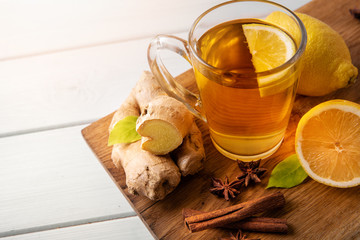 cup of ginger root tea with lemon