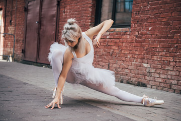 beautiful young ballerina dancing on street