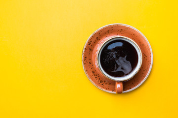 Coffe cup on yellow