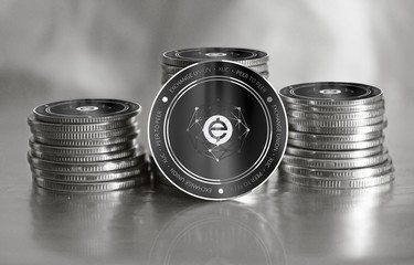 Exchange Union (XUC) digital crypto currency. Stack of black and silver coins. Cyber money.