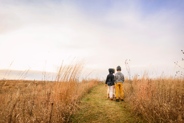 Portrait of a boy and girl standing in a field, United States