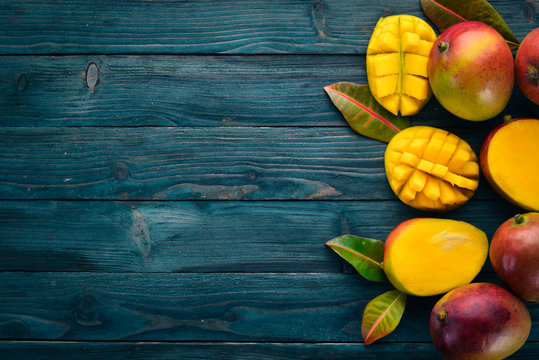 Mango. On a blue wooden background. Top view. Free copy space.