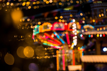 Abstract background with blurred carousel at the Christmas fair in Moscow city