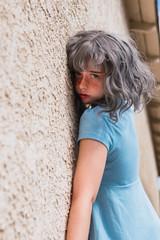 Sensual young woman near wall