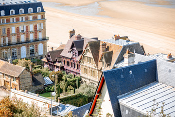 Luxury houses on the coastline with beautiful beach on the background in Trouville, famous french town in Normandy