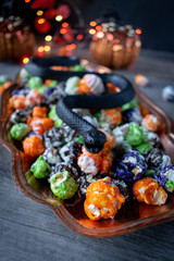 Halloween multi-colored popcorn party dish with snake