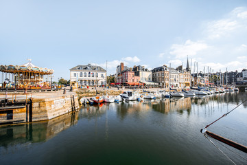 Landscape view on the beautiful harbour with yachts and old buildings in Honfleur, famous french town in Normandy