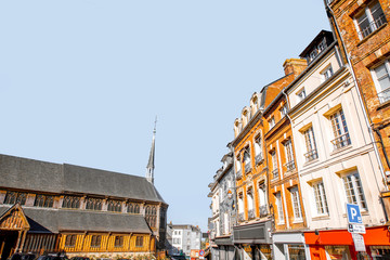Old buildings and church in the central square in Honfleur, famous french town in Normandy